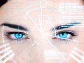 Blue eyed woman with interface — Stock Photo