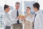 Group of business clinking their flutes of champagne — Stock Photo