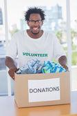 Happy man holding donation box — Stock Photo