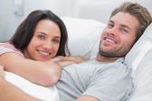Happy couple awaking and looking at camera — Stock Photo