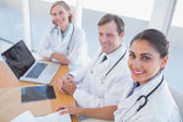 Overview of doctors looking at camera — Stock Photo