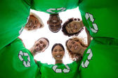 Low angle view of wearing green shirt with recycling symb — Stock Photo