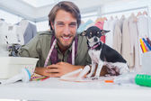 Fashion designer looking at camera with his chihuahua — Stock Photo