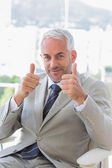 Happy businessman giving thumbs up — Stock Photo