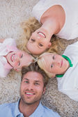 Family lying in a circle — Stock Photo