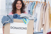 Volunteer holding clothes donation box — Stock Photo