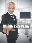 Businessman touching the term business plan — Stock Photo