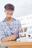 Cheerful designer working on graphics tablet — Stock Photo