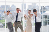 Group of business raising arms as a success — Stock Photo