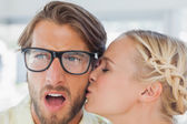 Attractive designer kissing her colleague — Stock Photo