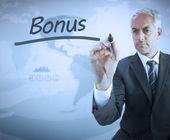 Businessman writing the word bonus — Stock Photo