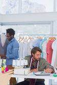Group of fashion designers working — Stock Photo