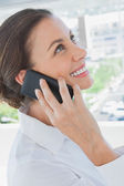 Smiling businesswoman having a phone conversation — Stock Photo
