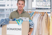 Handsome man holding donation box — Stock Photo