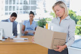 Sad businesswoman leaving office after being let go — Stock Photo
