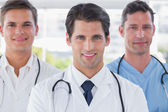 Smiling medical team standing — Stock Photo