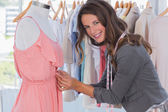 Attractive fashion designer picking needles — Stock Photo
