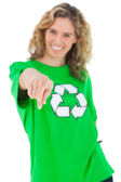 Smiling environmental activist wearing green shirt with recyclin — Stock Photo