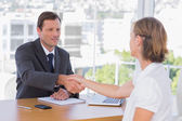 Businessman shaking hand of a job applicant — Stock Photo