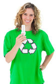 Environmental activist holding a light bulb — Stock Photo