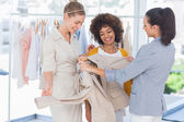 Fashion designers looking at a blazer — Stock Photo