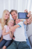 Father taking picture of his family — Stock Photo