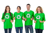 Group of environmental activists pointing their tshirt — Stock Photo