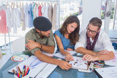 Three fashion designers working in a bright office — Stock Photo