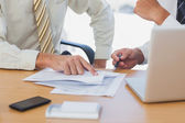 Businessmen going over paperwork — Stock Photo