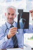 Attractive doctor showing a radiography — Stock Photo
