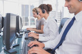 Call centre employees at work — Stock Photo