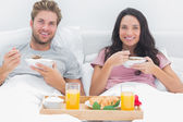 Couple eating cereal during a romantic breakfast — Stock Photo