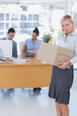 Forlorn businesswoman leaving office after being let go — Stock Photo