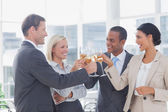 Business team celebrating with champagne and toasting — Stock Photo