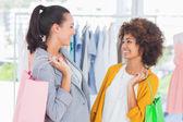 Smiling women holding shopping bags — Stock Photo