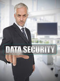 Businessman touching the term data security — Stock Photo