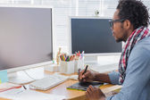 Graphic designer using a graphics tablet — Stock Photo