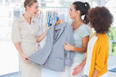 Smiling women holding a blazer — Stock Photo