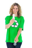 Environmental activist holding energy saving light bulb and a li — Stock Photo
