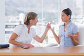 Businesswomen arguing together — Stock Photo