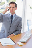 Serious businessman on the phone — Stock Photo