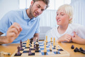 Father and his son playing chess together — Stock Photo