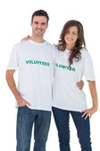 Two cheerful wearing volunteer tshirt — Stock Photo