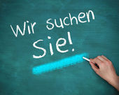Hand writing wir suchen sie — Stock Photo