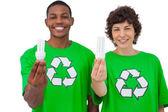 Two environmental activists holding light bulbs — Stock Photo