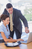 Business working together on the same laptop — Stock Photo