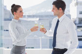Serious business clinking their flutes of champagne — Stock Photo