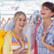 Stock Photo: Two cheerful friends holding shopping bags