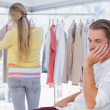 Bored man while his girlfriend is shopping — Stock Photo #26990171
