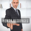 Businessman touching the term human resources — Stock Photo #26990319